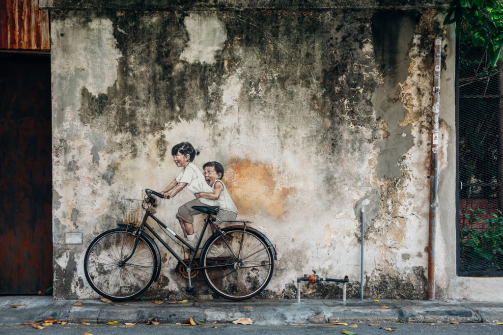 Mural Kids on bicycle by Ernest Zacharevic