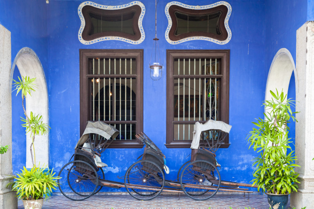 Old rickshaw tricycles near Fatt Tze Mansion also known as Blue Mansion