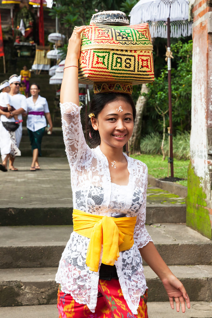 The young Balinese woman with a basket for offerings, Ubud, Bali, Indonesia