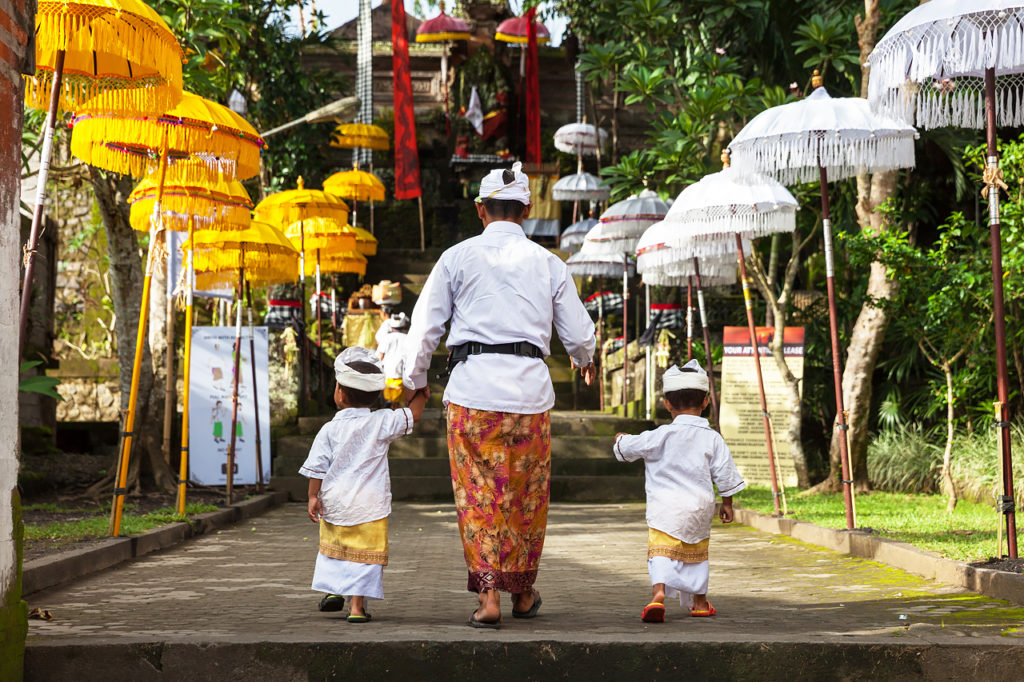 The Balinese family at the temple in Ubud, Bali, Indonesia