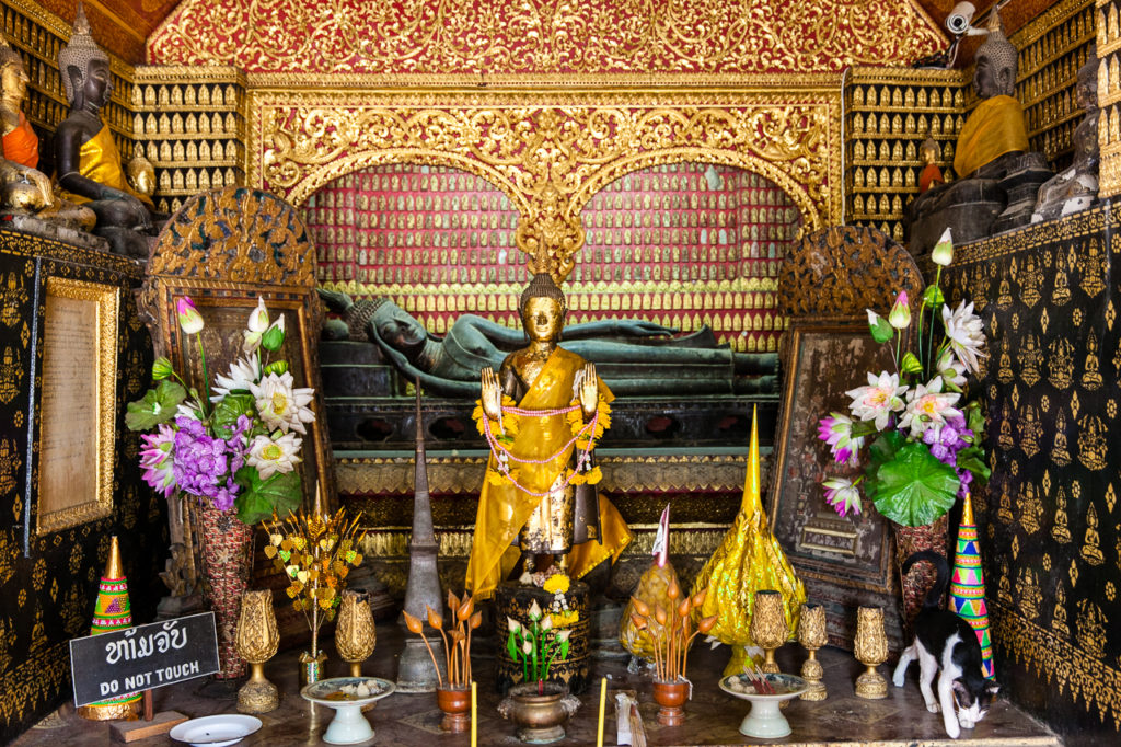 The rare reclining Buddha in Wat Xieng Thong, Luang Prabang, Laos