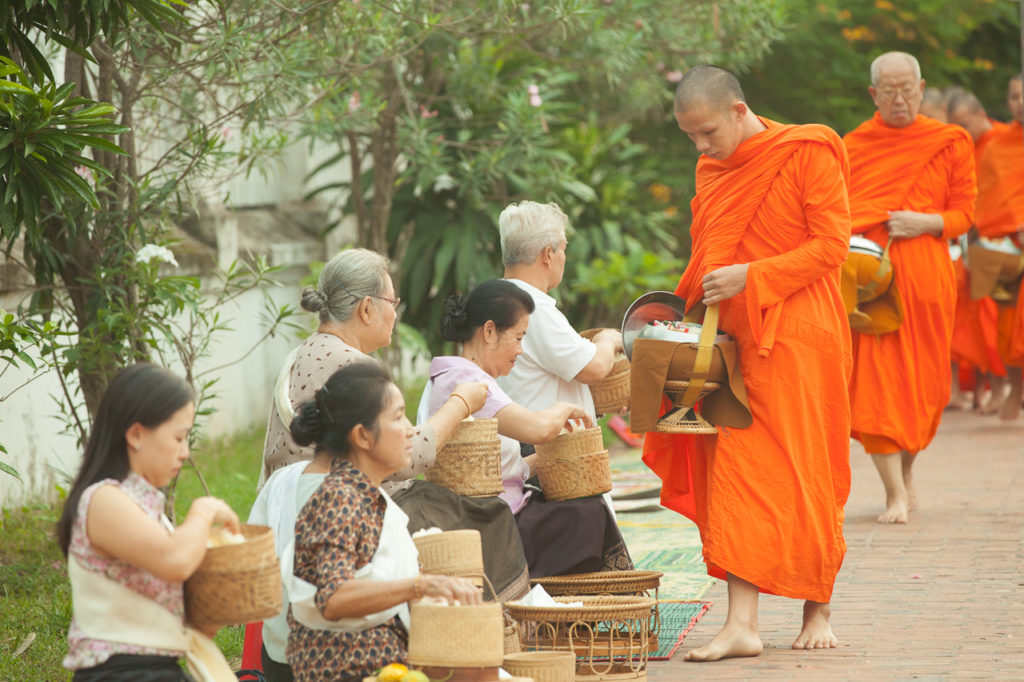 Lao people give alms to Buddhist monks, Luang Prabang, Laos