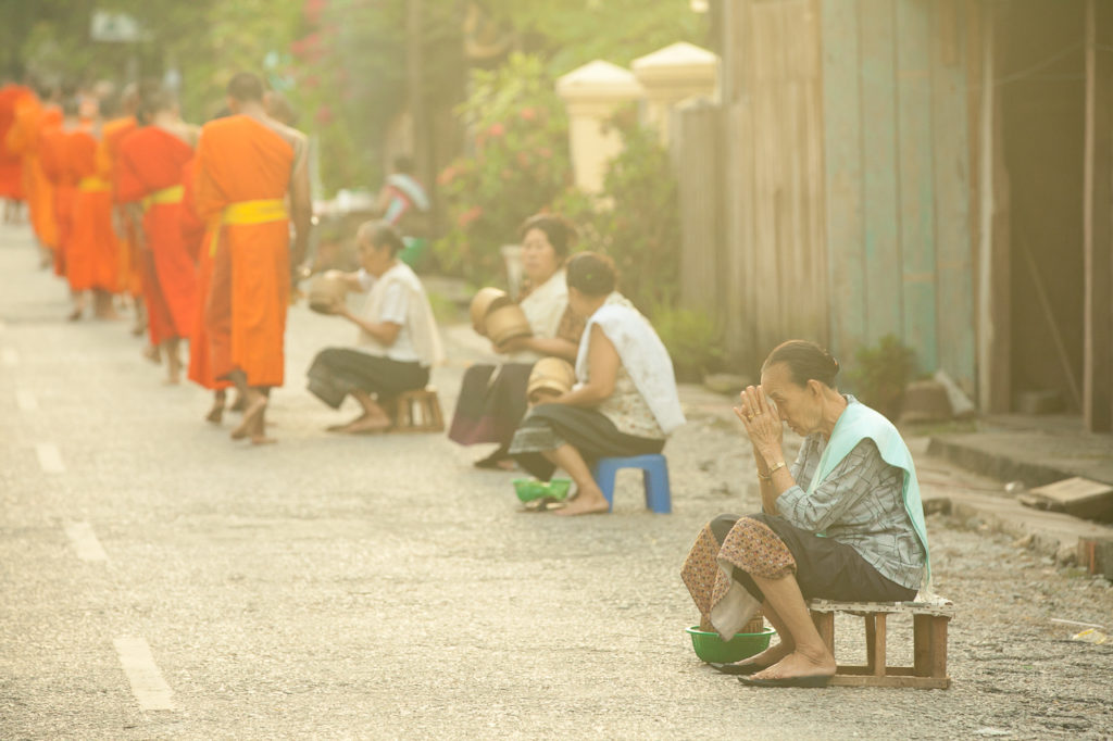 A woman prays after the ceremony, Luang Prabang, Laos