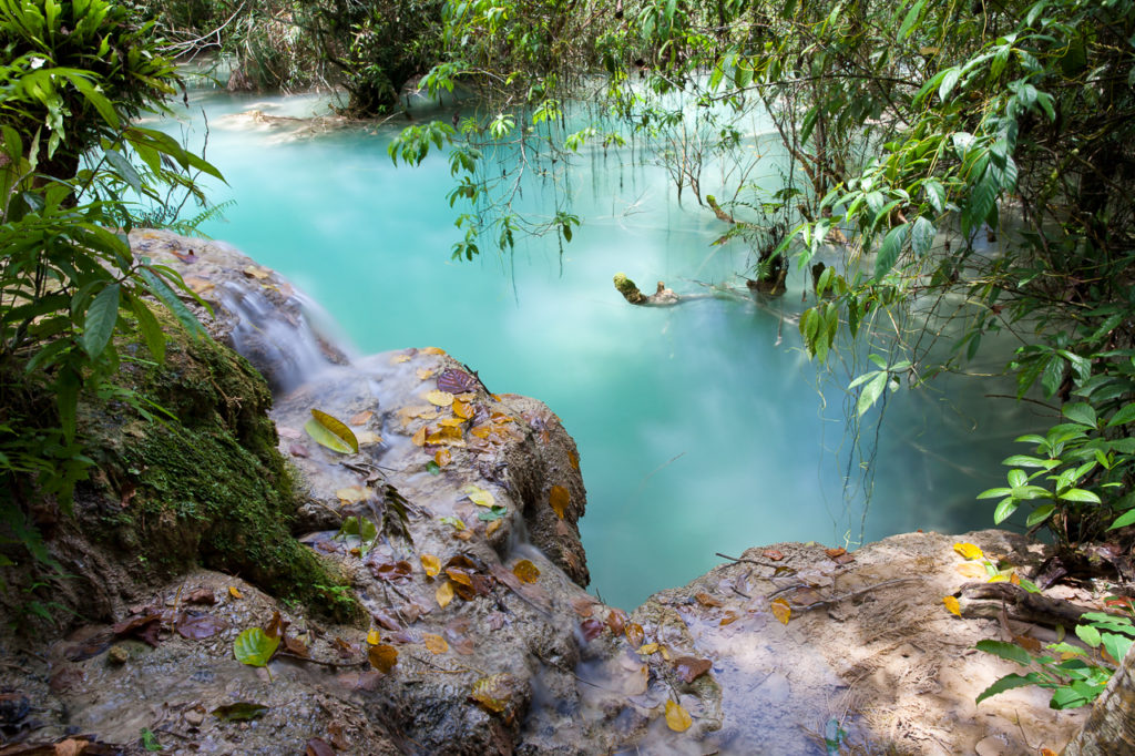 Amazing turquoise water of Kuang Si waterfalls, Laos