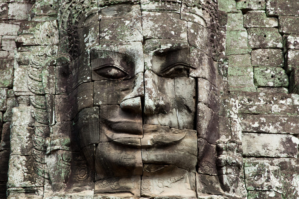 The stone face of on the wall of Bayon Temple