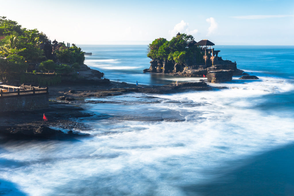 Pura Tanah Lot temple washed by the Ocean waves, Bali, Indonesia