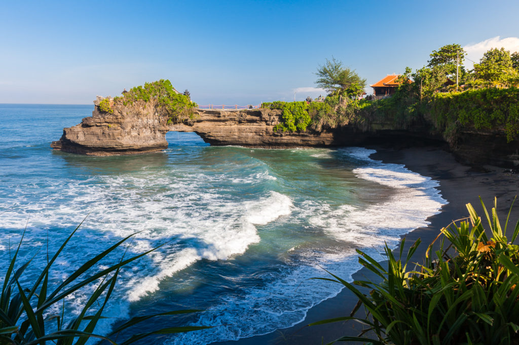 The Pura Batu Bolong temple on the beautiful rock, Tanah Lot, Bali, Indonesia