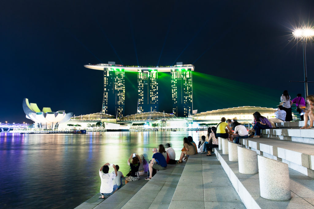 People watching the show from Merlion Park on the other side of Marina Bay