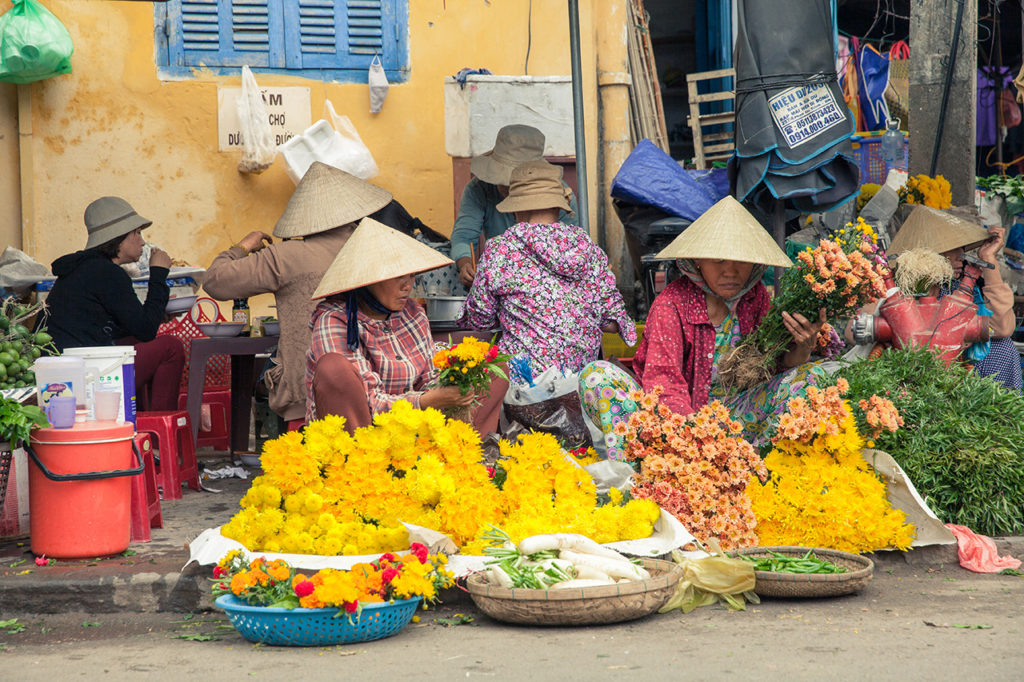 Hoi An, Vietnam: Flower vendors at the street market