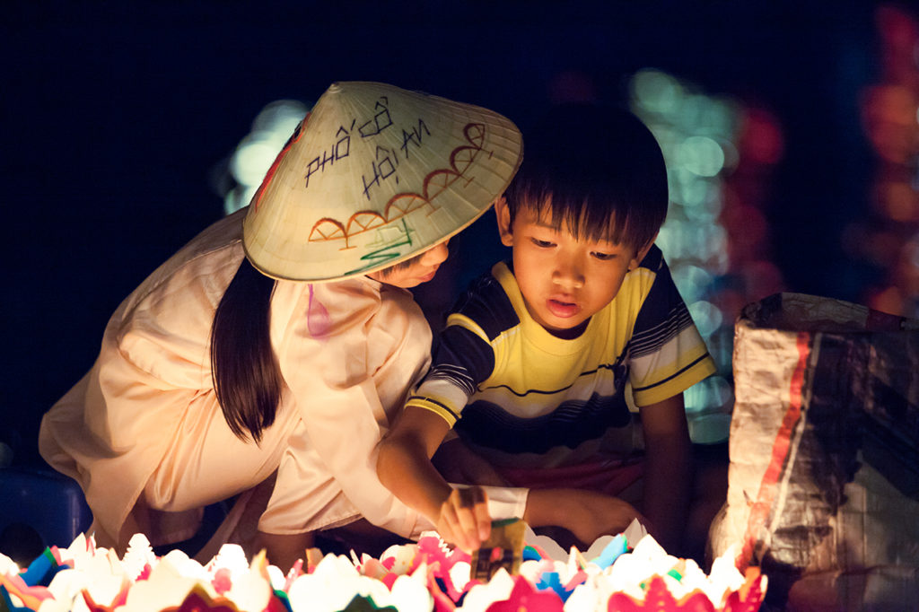 Hoi An, Vietnam: Kids sell candles during the Full Moon Festival