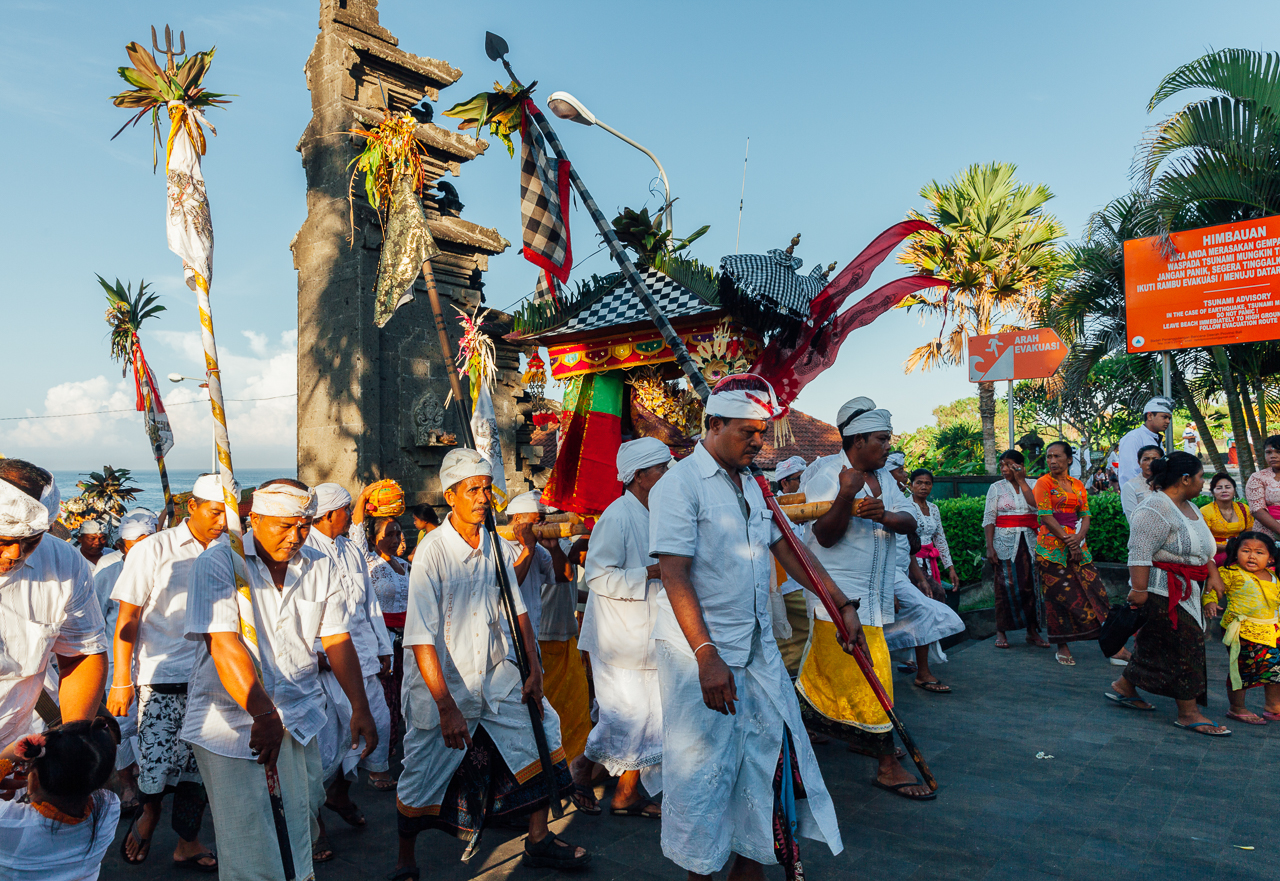 Nyepi Balinese New Year: Balinese people in traditional clothes carry jempana (palanquin)