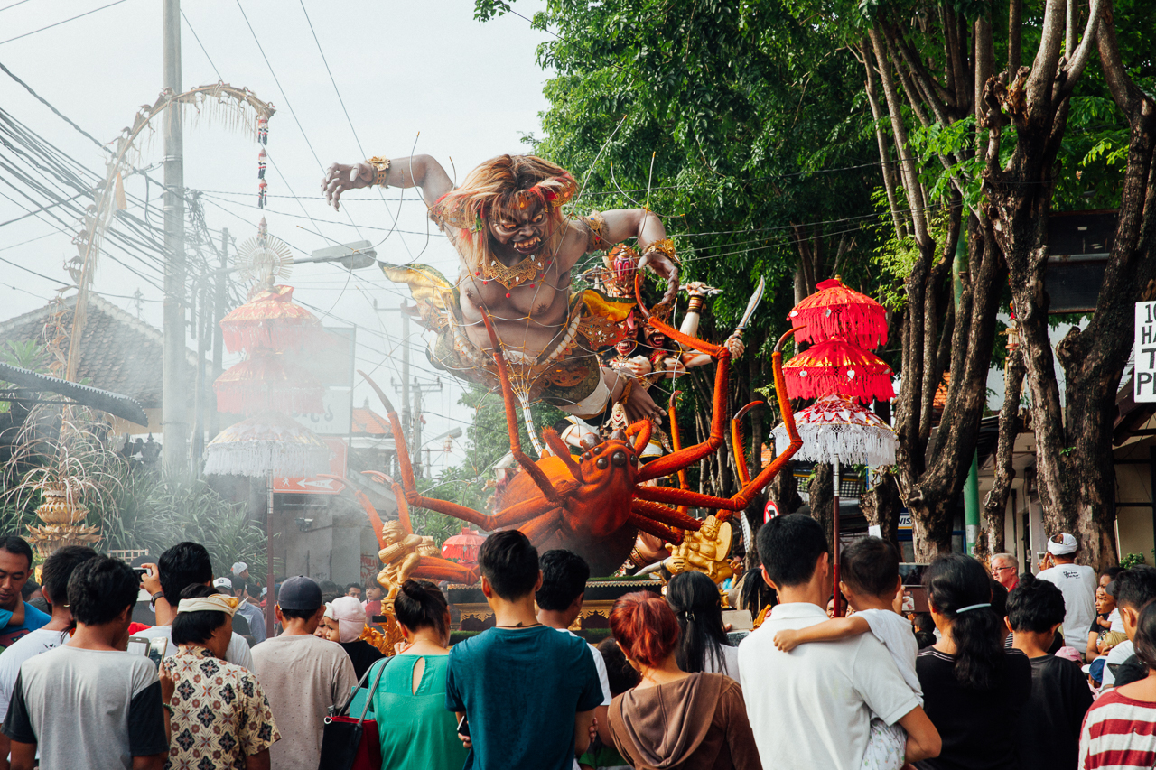 Nyepi Balinese New Year: People watch Ogoh-Ogoh statues before the parade